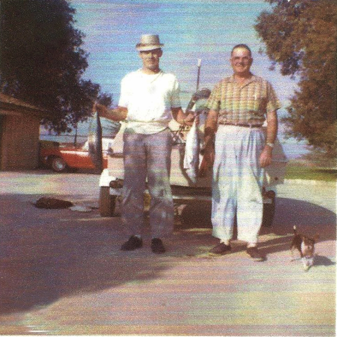 Left to right, me and Uncle Louie Yett in the driveway of the Spalding house showing some bonito fish caught in the ocean near Redondo Beach, California.
